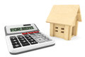 Wooden House with Calculator Royalty Free Stock Photo
