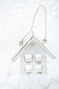 Wooden house christmas decoration on white snow background Stock Image