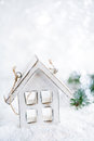 Wooden house christmas decoration on white snow background and glitter Royalty Free Stock Photo