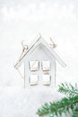 Wooden house christmas decoration on white snow background and glitter Royalty Free Stock Images
