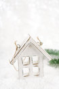 Wooden house christmas decoration on white snow background glitter Stock Images