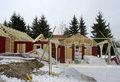 Wooden house construction at winter time of a Stock Images