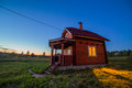 Wooden house exterior with lights night Royalty Free Stock Photo