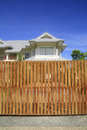 Wooden house fence and blue sky Stock Photos
