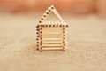 Wooden house made of matches. Handmade. Blurring background. Free place. Royalty Free Stock Photo