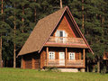 Wooden house on the nature in the pine forest Stock Photography