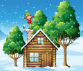 A wooden house with a playful elf at the rooftop illustration of Royalty Free Stock Photos