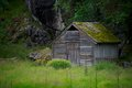 Wooden house in scandinavian landscape Royalty Free Stock Photo