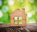 Wooden house symbol on nature background Stock Photos