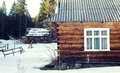 Wooden house in winter forest, Mountains Royalty Free Stock Photo