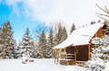 Wooden house during winter Royalty Free Stock Photo
