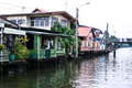 Wooden houses along the canals in thailand Stock Image
