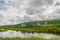 Wooden houses in nature next to pond denali highway alaska usa Royalty Free Stock Photos