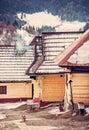 Wooden houses in Vlkolinec village, Slovakia, red filter
