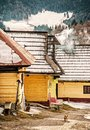 Wooden houses in Vlkolinec village, Slovakia, yellow filter