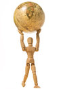 Wooden human model hold the world isolated on white background map Royalty Free Stock Image