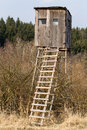 Wooden hunters high seat hunting tower in rural landscape czech republic scenery Royalty Free Stock Images