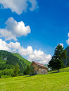 Wooden hut in the alps surrounded by beautiful alpine landscape Stock Image