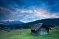 Wooden hut by geroldsee lake during sunrise rainy bavaria germany Royalty Free Stock Images