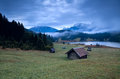 Wooden hut and morning fog over geroldsee lake bavarian alps germany Royalty Free Stock Photography