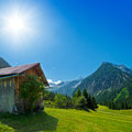 Wooden hut in the mountains rural scenery with Stock Image
