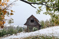 Wooden hut and a snowstorm in the mountains carpathians Stock Photo