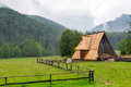 Wooden hut under tatra mountains in zakopane poland Stock Photo