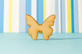 Wooden icon of butterfly on blue striped background Royalty Free Stock Photo