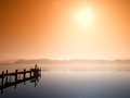 Wooden jetty in morning fog Stock Photo