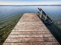 Wooden jetty old at a lake Stock Photo
