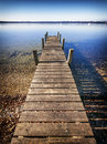 Wooden jetty old at a lake Royalty Free Stock Image