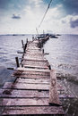 Wooden jetty to saltwater fish floating cage Royalty Free Stock Images