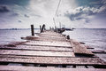 Wooden jetty to saltwater fish floating cage Royalty Free Stock Image