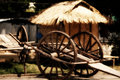 Wooden Kart_ Straw Hut Stock Photos