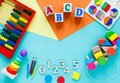Wooden kids toys on colourful paper. Educational toys blocks, pyramid, pencils, numbers, train. Toys for kindergarten Royalty Free Stock Photo