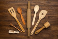 Wooden kitchen tools on vintage wooden background Royalty Free Stock Photo