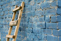 Wooden ladder against wall Stock Images