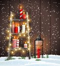 Wooden ladder with Christmas candles, lights and lantern