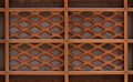 Wooden lath with a grid of thin strips Royalty Free Stock Image