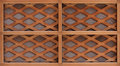 Wooden lath with a grid of thin strips Royalty Free Stock Photos