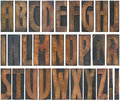 Wooden letters cutout old wood type capital alphabet isolated with clipping path Stock Images