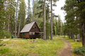 Wooden lodge in forest Stock Photos