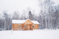 Wooden log house in winter forest Royalty Free Stock Photo