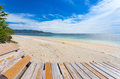 Wooden lounger lonely beach tropics Stock Photos
