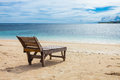 Wooden lounger lonely beach tropics Royalty Free Stock Photography