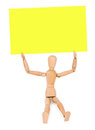 Wooden man holds a note paper Stock Photos