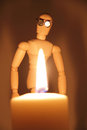 Wooden man looking at dangerous fire Stock Images