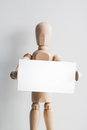 Wooden mannequin with a business card. Royalty Free Stock Photo