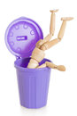 Wooden mannequin doll upside down in purple dustbin isolated can on white background Stock Photos