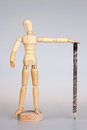 Wooden mannequin with pencil Royalty Free Stock Images